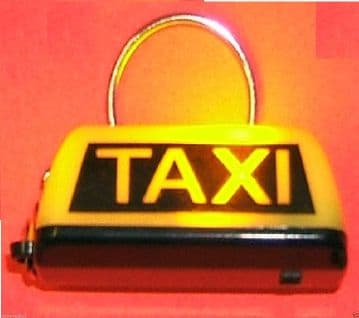 TAXI KEY RING IN YELLOW WITH SWITCH TO ILLUMINATE TAXI YELLOW